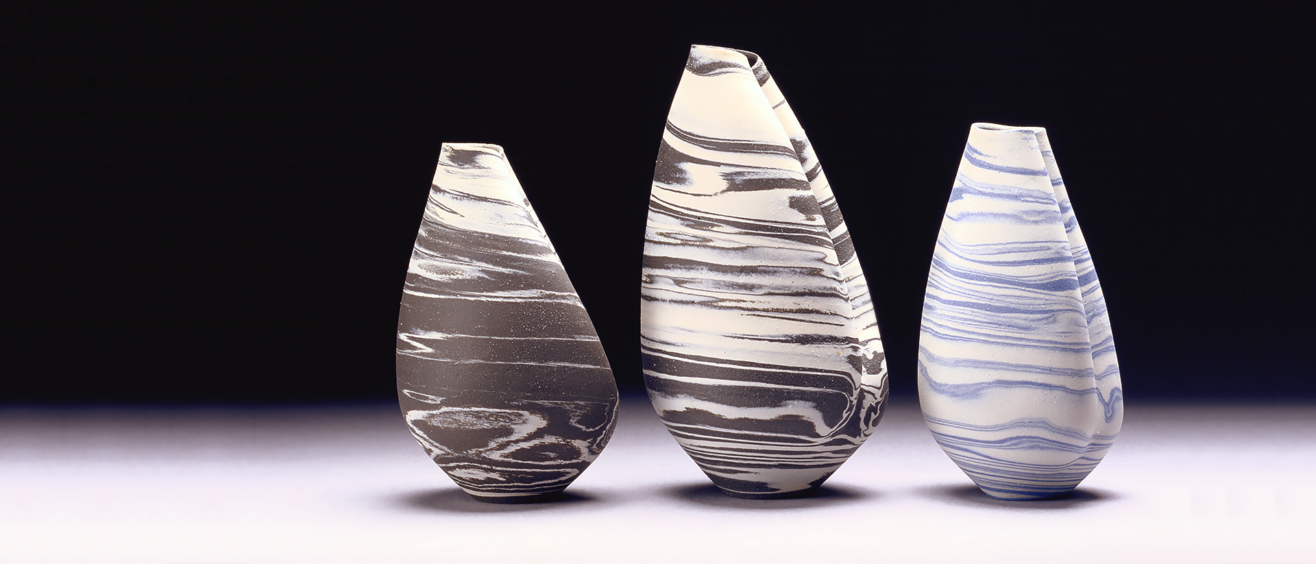 Robin Hopper, Shell Forms No.5, 1 and 2, 1974, ceramic, left to right: No.5: 20 cm x 12 cm (86-115), No. 1: 26 cm x 14 cm (86-113), No. 2: 20 cm x 13 cm (86-114). Collection: Canadian Museum of History